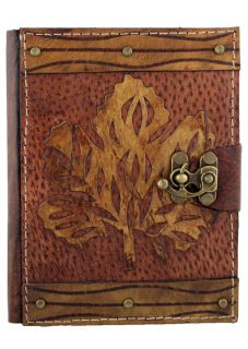 Leaf on A Brown Leather Bound Journal Notebook Diary Sketchbook