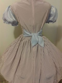 this candystripe dress is made of pink brown striped shiny poly fabric