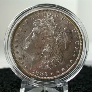 1883 O Morgan Silver Dollar UNC Lightly Toned