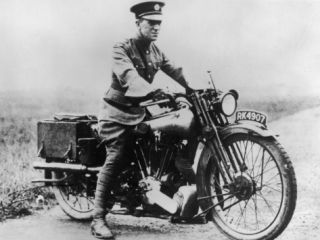 T E Lawrence (Lawrence of Arabia) Sitting on His Motorbike Photographic Print