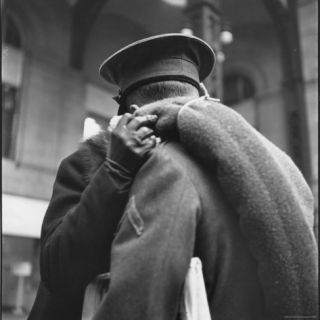 Rear View of Couple in Penn Station Sharing Farewell Kiss Before He Ships Off to War During WWII Photographic Print by Alfred Eisenstaedt