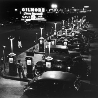 Gilmore Gas Station Featuring Eight Islands, Three Pumps Each, Girl Makes Change Every Two Islands Photographic Print by Allan Grant