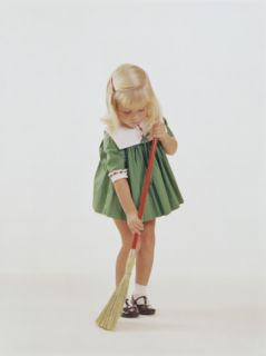 Young Girl Sweeping Floor with Broom Photographic Print by Dennis Hallinan