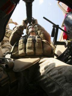 A Marine Rocks His M 2 50 Caliber Machine Gun at Camp Fallujahs Eagle Range Photographic Print by Stocktrek Images