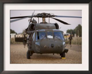 A UH 60L Black Hawk with Twin M240G Machine Guns at the Victory Base Complex in Baghdad, Iraq Art