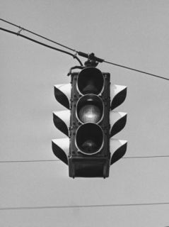 Traffic Lights Hanging on Wire, Low Angle View Photographic Print by George Marks