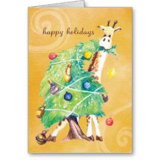 Giraffe nibbling on Christmas Tree Greeting Cards