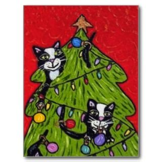 christmas card has black and white cats climbing in the christmas tree