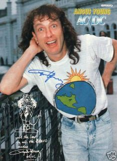 Angus Young AC/DC Autogramm A4 Zeitungsbild