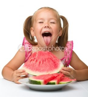 Cute little girl is going to eat watermelon  Stock Photo