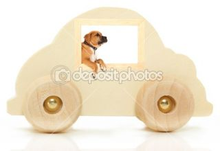 Wooden Car Toy with Boxer in Window  Foto Stock © Jaimie Duplass