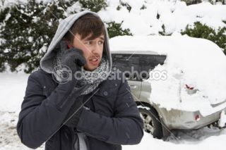 Young man in snow with broken down car  Foto Stock © Monkey Business