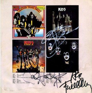 Autographed KISS 12x12 book page Collectibles