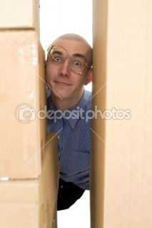 Male face clamping between cardboard box  Stock Photo © pz.axe