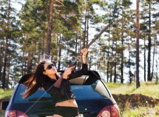 Girl with gun  Stock Photo © Alexander Podshivalov #1417738
