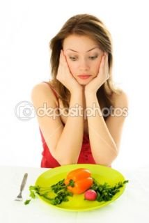 Sad girl keeping a diet  Stock Photo © Svetlana Khvorostova #1916382